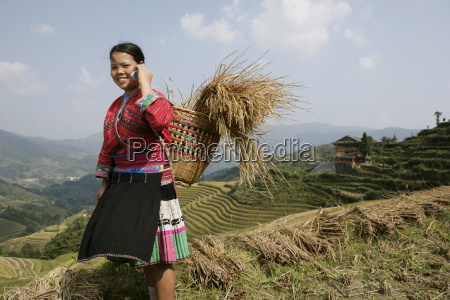 woman of yao minority with cellphone