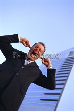 business man with fingers in his