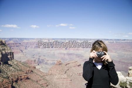 woman taking photos grand canyon national