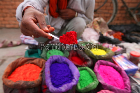 a dye trader offers his brightly