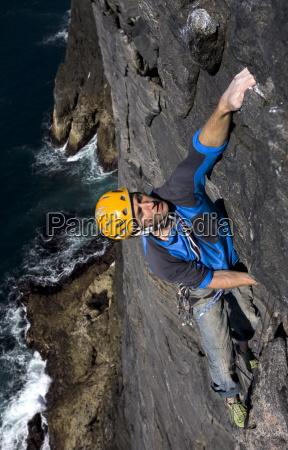 a climber makes his way up
