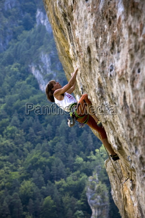 rock climber tackles a very overhanging
