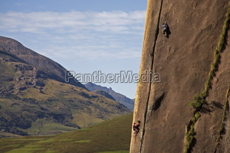 two rock climbers making their way