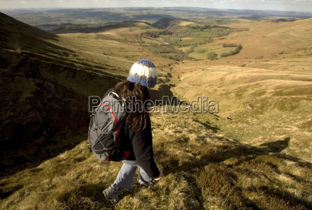 a hiker enjoys solitude in the