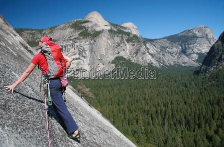 a rock climber ascends slabs at