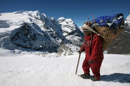 a high altitude porter carries a