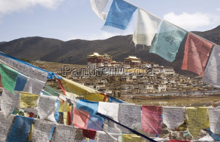 prayer flags and ganden sumsteling gompa