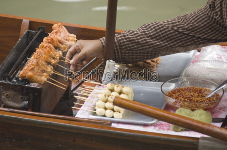 food being cooked and sold on