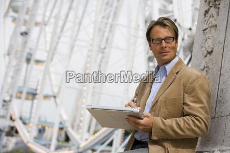 professional man at a fairground paris