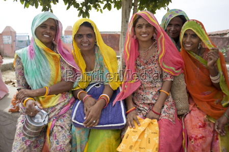 women waiting for village jeep after