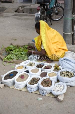 street spice seller in yellow sari
