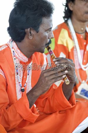 hindu musician dressed in orange clothing