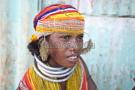 bonda tribeswoman wearing traditional bead costume