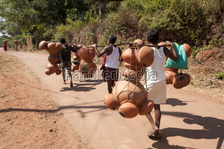 bonda tribesmen walking to market carrying