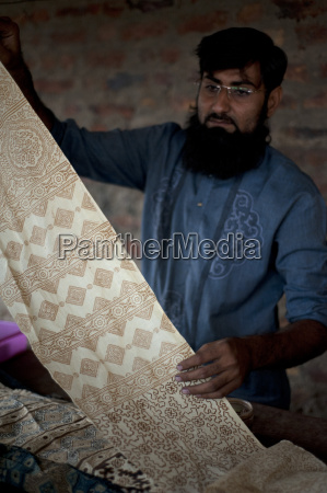 muslim man showing hand block printed