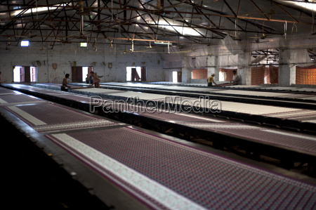 screenprinting factory men printing sari lengths