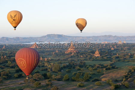 hot air balloons flying over the