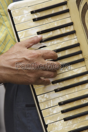 hand on accordion keyboard paris france
