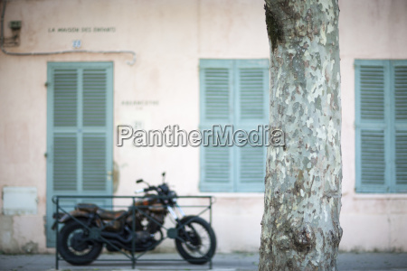 old motorbike next to shuttered building