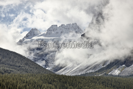 snow covered mountains among the clouds