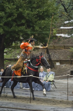 traditional costume and horse ceremony for