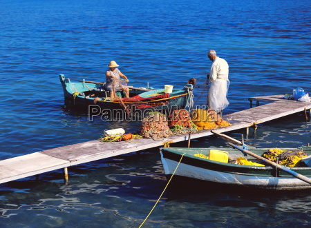 fisherman and his wife cleaning the