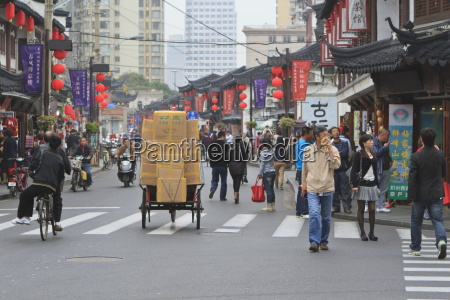 pedestrians and traffic on shanghai old