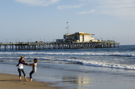 girls enjoying the seaside near santa