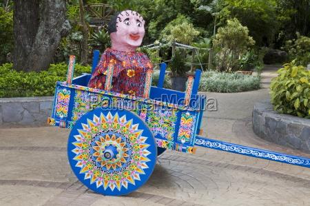 masquerade costume on ox cart festival