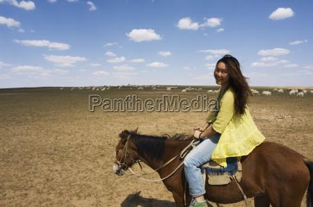 chinese girl horseriding xilamuren grasslands inner