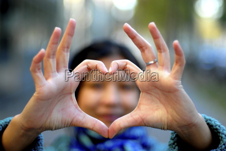 woman making a heart with her