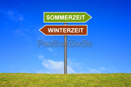 signpost summer time and winter time