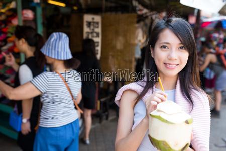 woman enjoy coconut drink in weekend