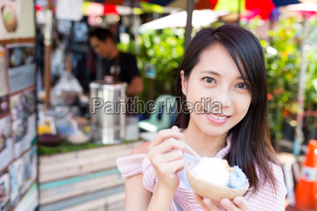woman enjoy coconut ice cream in