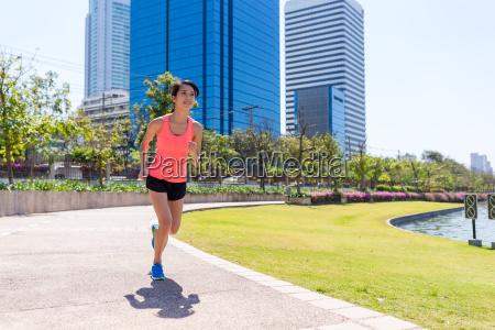 woman running at benjakitti park
