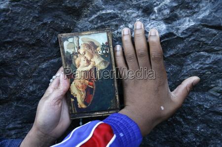pilgrims touching the lourdes grotto lourdes