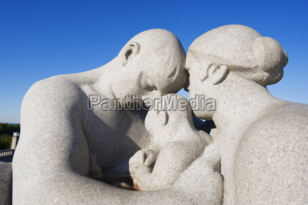 parent and child stone sculpture by