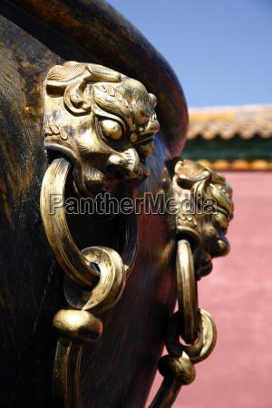 lion handle on a bronze urn