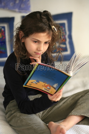 an 8 year old girl reading