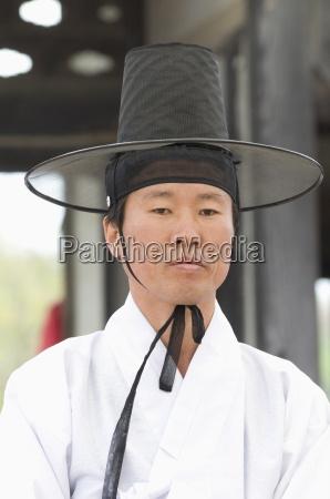 korean man dressed in traditional wedding