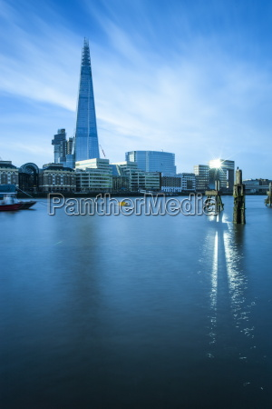 the shard building beside the river
