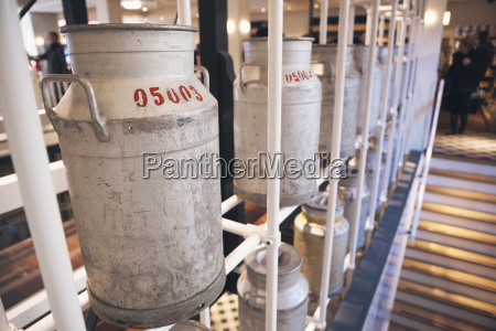 milk churns in the cheese factory