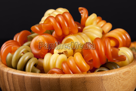 spiral pasta trottole tricolore isolated in
