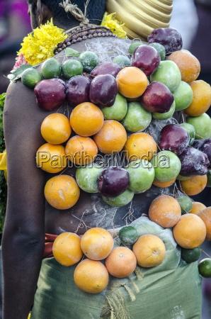 a pierced devotee laden with fruit