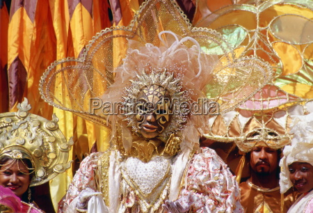 carnival dancers wearing traditional costumes in