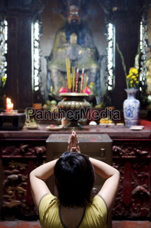 local woman praying and meditating in