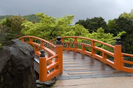 vermilion colored arched bridge at murasaki