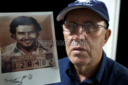 roberto escobar with a picture of