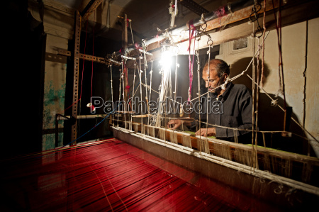 a weaver at work making a