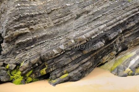 folded layers of jurassic sedimentary limestone